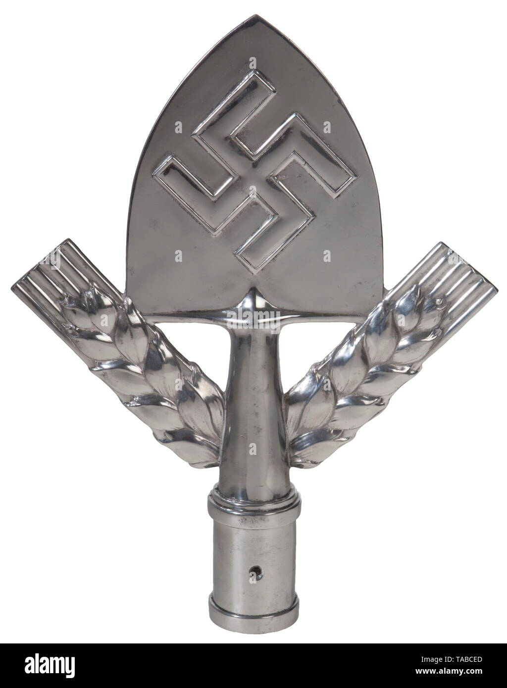 An RAD pole top Polished aluminium spade with swastika and wheat sheaves with pole cup stamped with designer's initials 'PC' and on bottom edge 'Ges. Gesch', 'JMME & SOHN'. Height 30 cm. USA-lot, see page 4. historic, historical, Reichsarbeitsdienst, Reich Labor Service, State Labour Service, organisation, organization, organizations, organisations, NS, National Socialism, Nazism, Third Reich, German Reich, Germany, National Socialist, Nazi, Nazi period, fascistic, fascism, utensil, piece of equipment, utensils, accessory, accessories, object, objects, stills, clipping, cli, Editorial-Use-Only - Stock Image