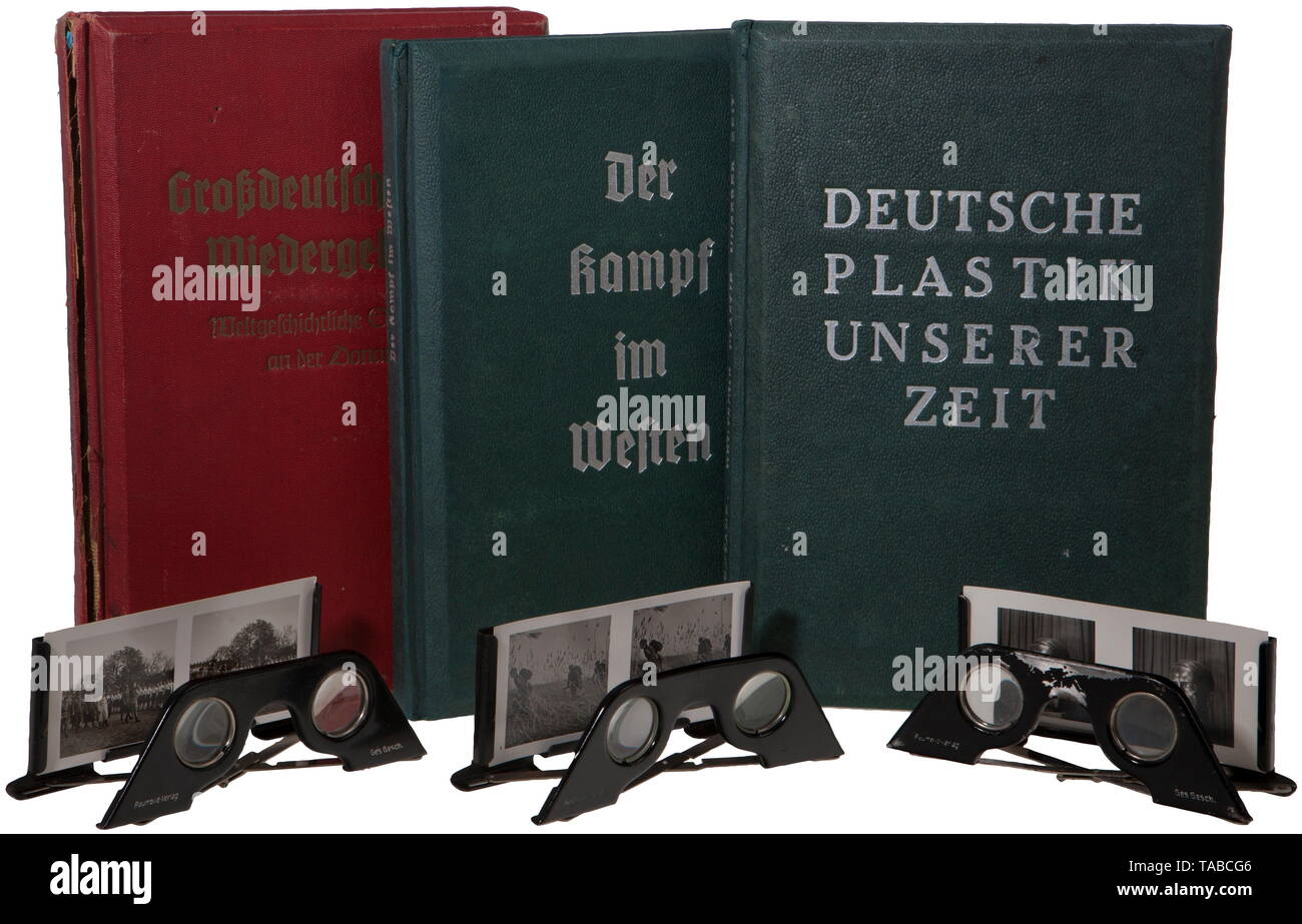 """A group of three Third Reich 3-D albums Consists of """"Der Kampf im Westen"""" missing card #9, with viewer. """"Deutsche Plastik unserer Zeit"""" with viewer but missing a few cards. """"Großdeutschlands Wiedergeburt"""" complete with viewer. Some spine damage. Each approximately 30 x 20 cm. USA-lot, see page 4. historic, historical, 20th century, Editorial-Use-Only Stock Photo"""