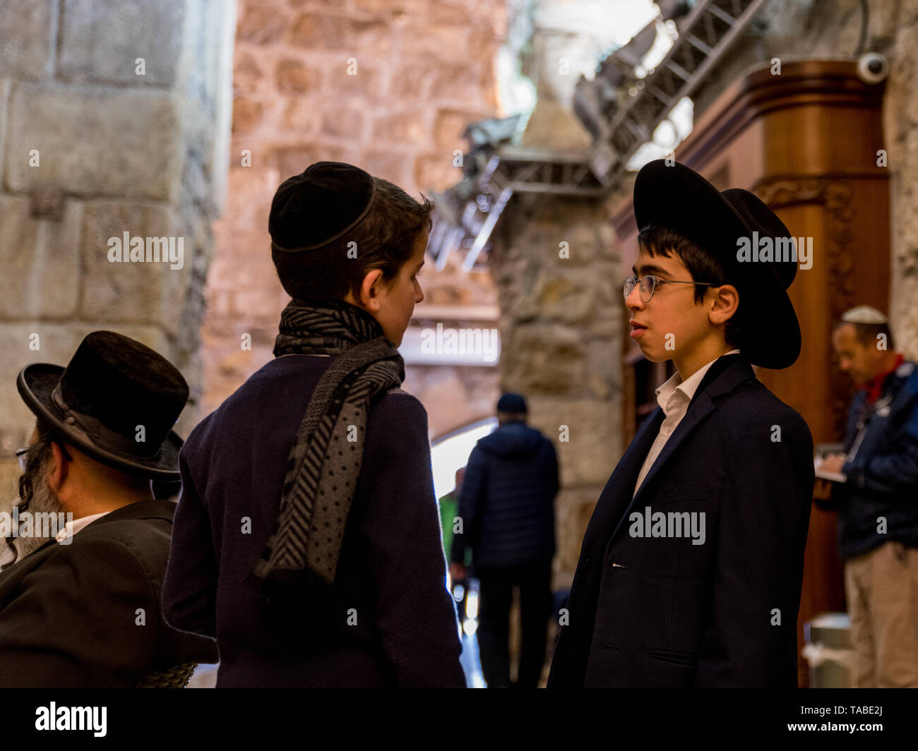 Jerusalem,Israel,29-march-2019:Tow jew boys talking in the streets of jerusalem,jerusalem is the religious centre - Stock Image