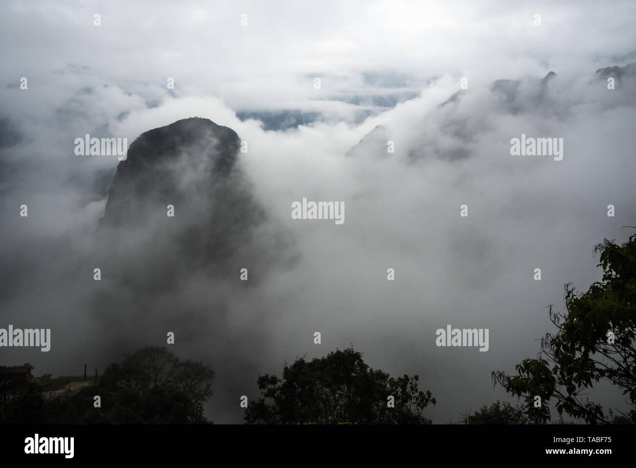 Mountains around Machu Picchu among the morning mists, Cuzco Peru - Stock Image