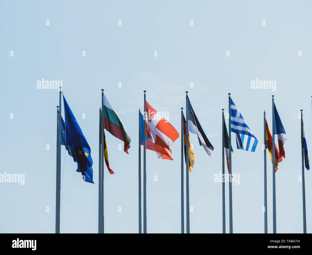 The Member States of the European Union French, Eu, Hungary, Estonia, Germany, Spain, Greece waving in calm weather with blue sky in background a day before European parliamentary elections in Europe - Stock Image