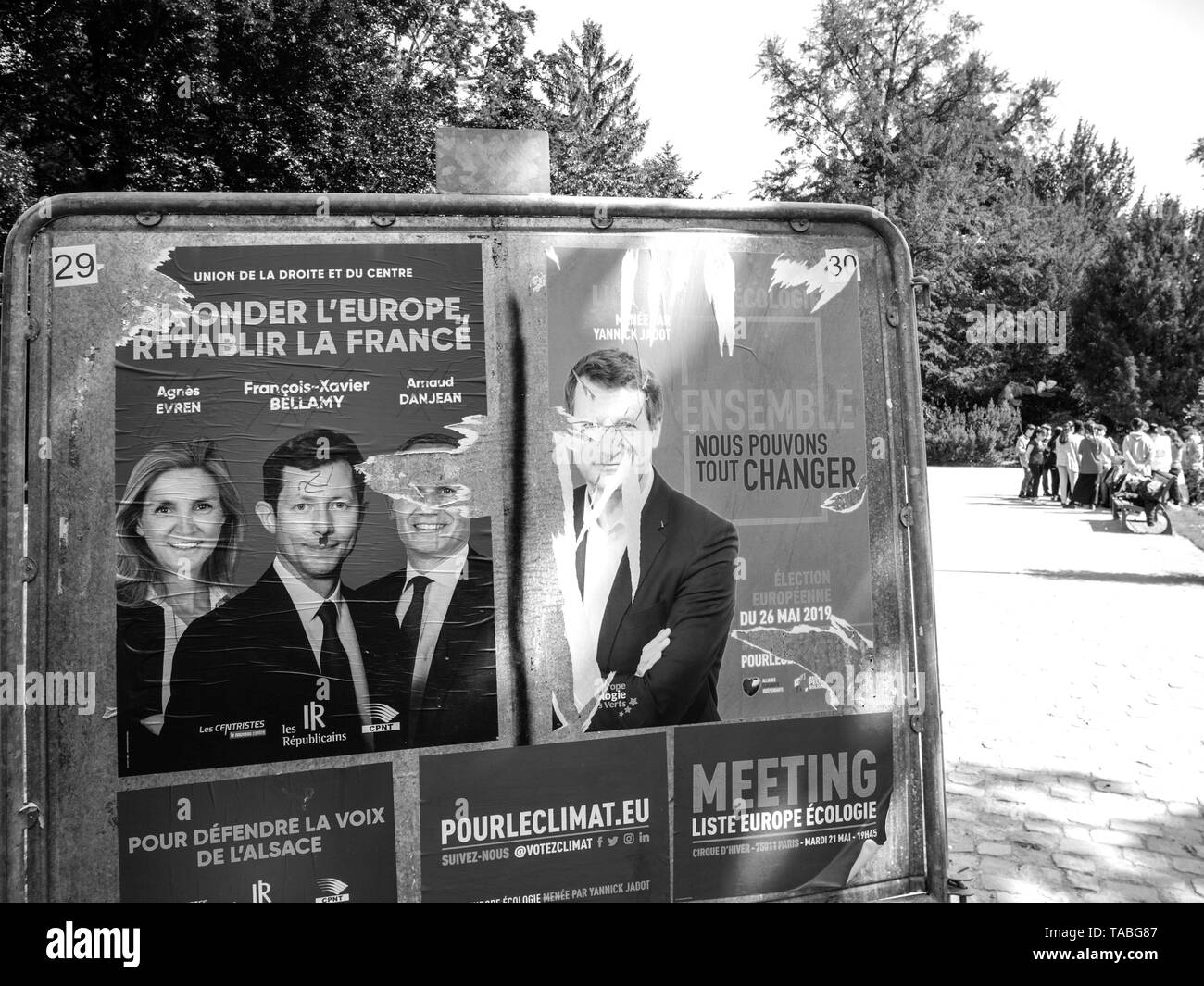 Strasbourg, France - May 23, 2019: Posters in green sunny park for 2019 European Parliament election featuring French politiciains from Les Republicains and Ecologist party - young kids in background - Stock Image