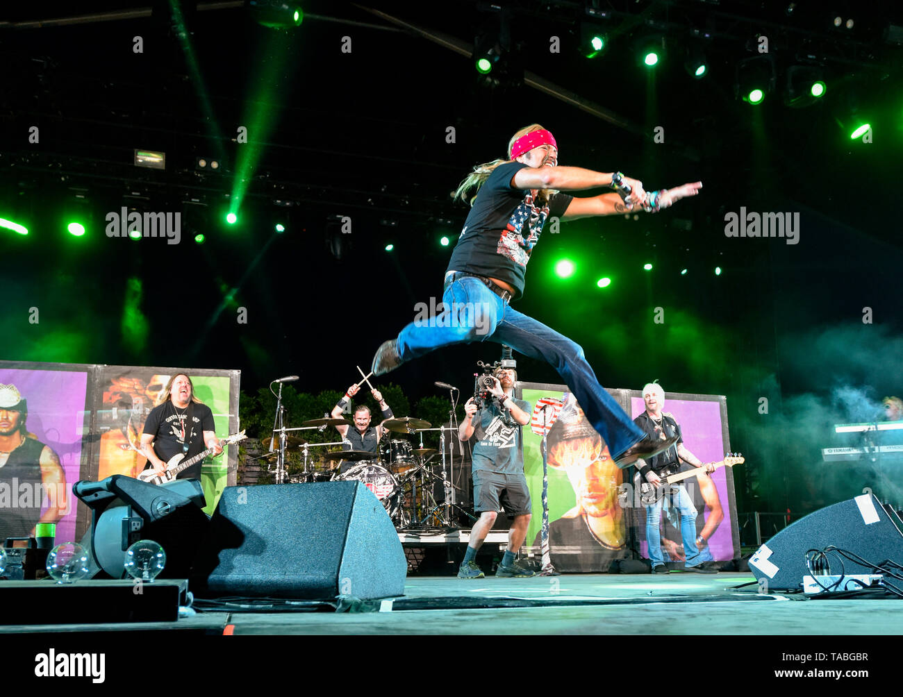 Indio, California, April 26, 2019, Bret Michaels Band on stage performing to an energetic crowd on day 1 of the Stagecoach Country Music Festival. Stock Photo