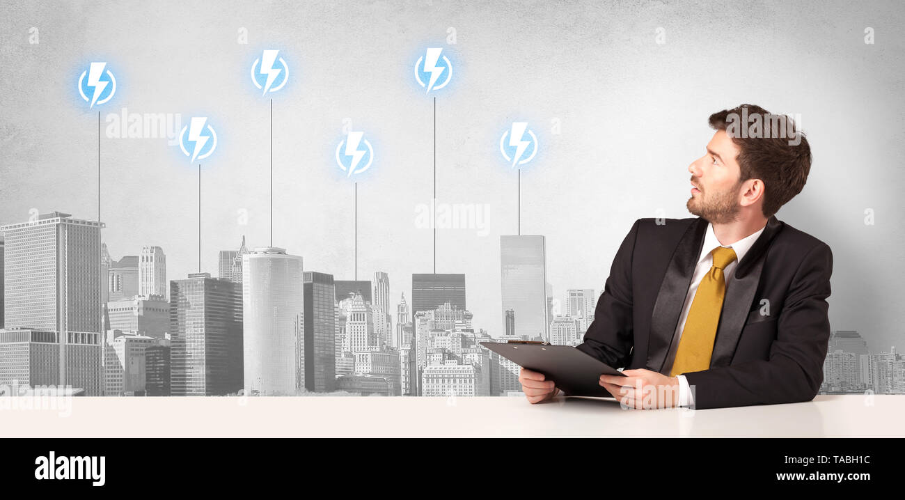 Announcer sitting at desk presenting the city energy consumption  - Stock Image