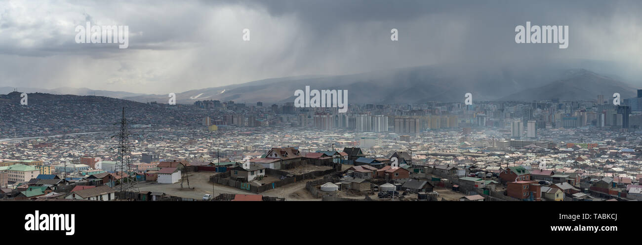Panoramic view of Mongolian cityscape against a gray sky. - Stock Image