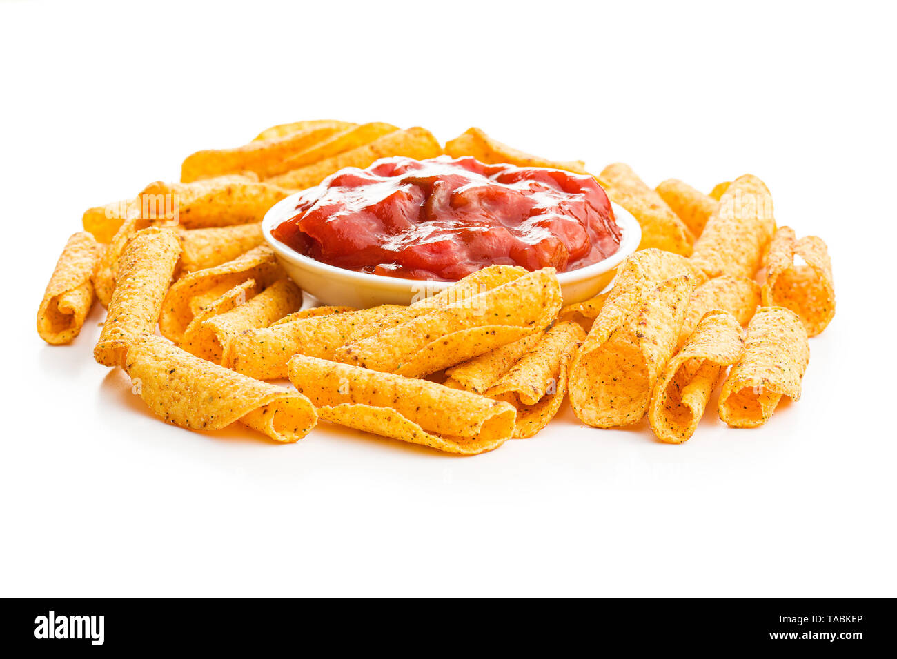 Rolled mexican nacho chips and salsa dip isolated on white background. - Stock Image