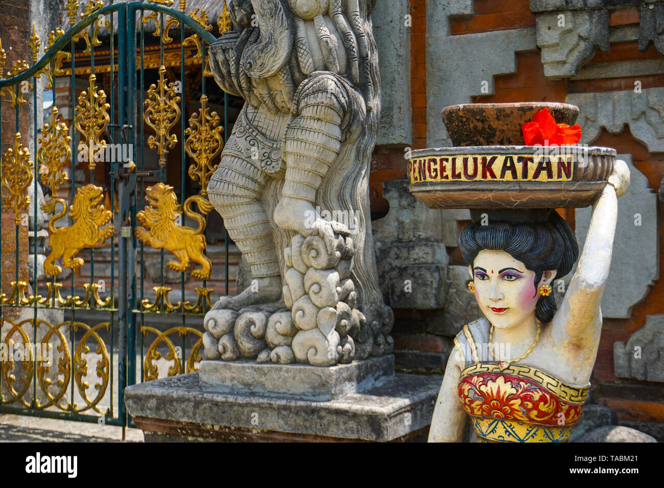 Balinese woman statue holding on his head offerings and gifts to the gods at the Balinese Temple, Bali, Indonesia, 10.08.2018 - Stock Image