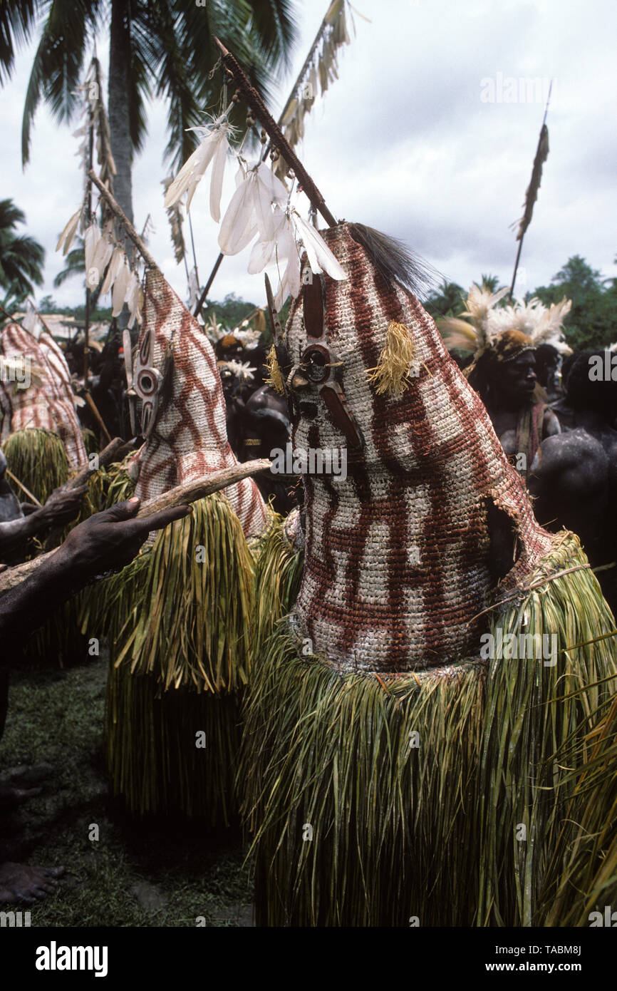 Asmat people: ethnic group living in the Papua province of Indonesia, along the Arafura Sea.  Masked personages during a festival ('Killing evil soul  - Stock Image