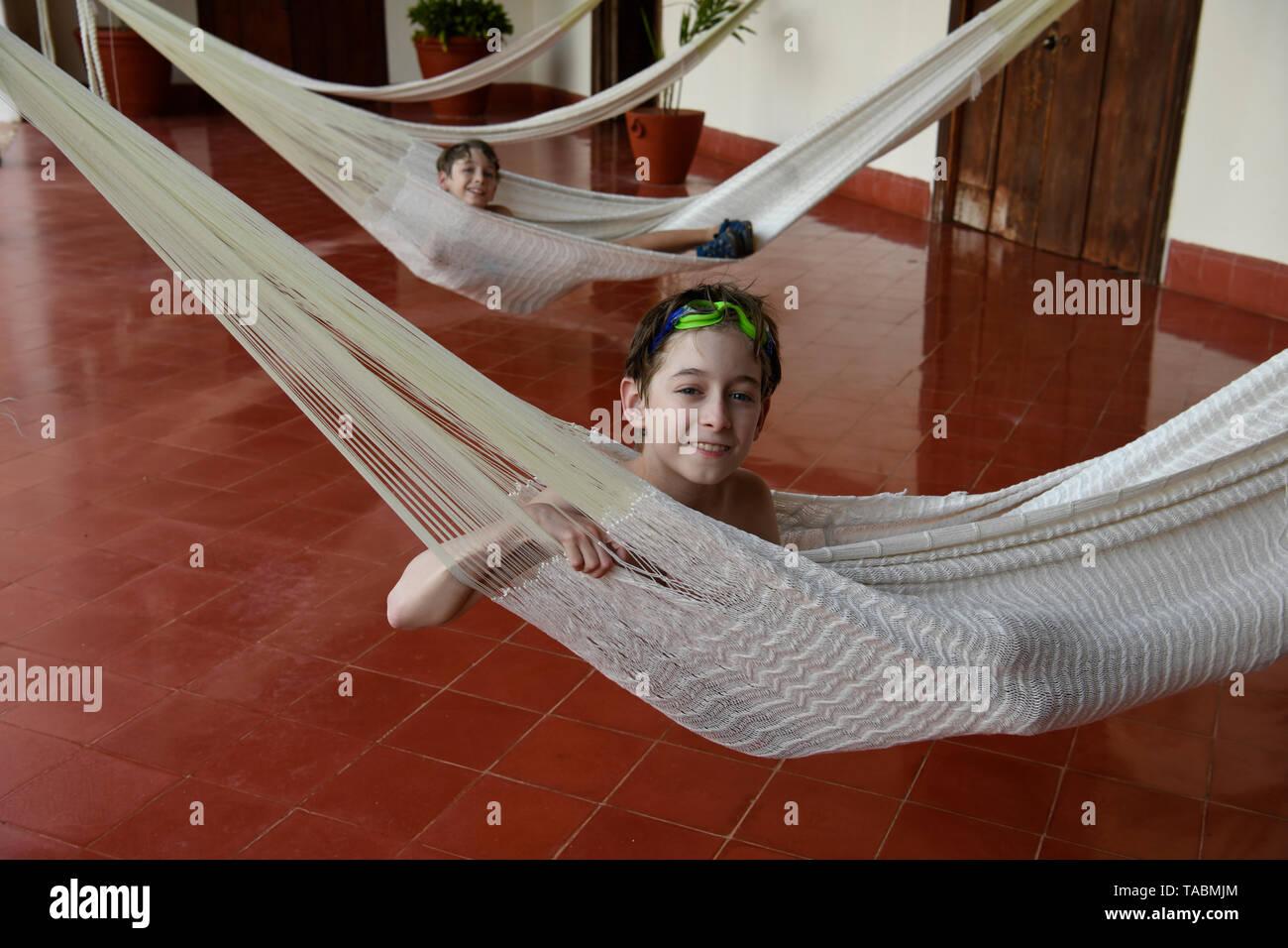 Boy in Mexican hammock having a siesta - Stock Image