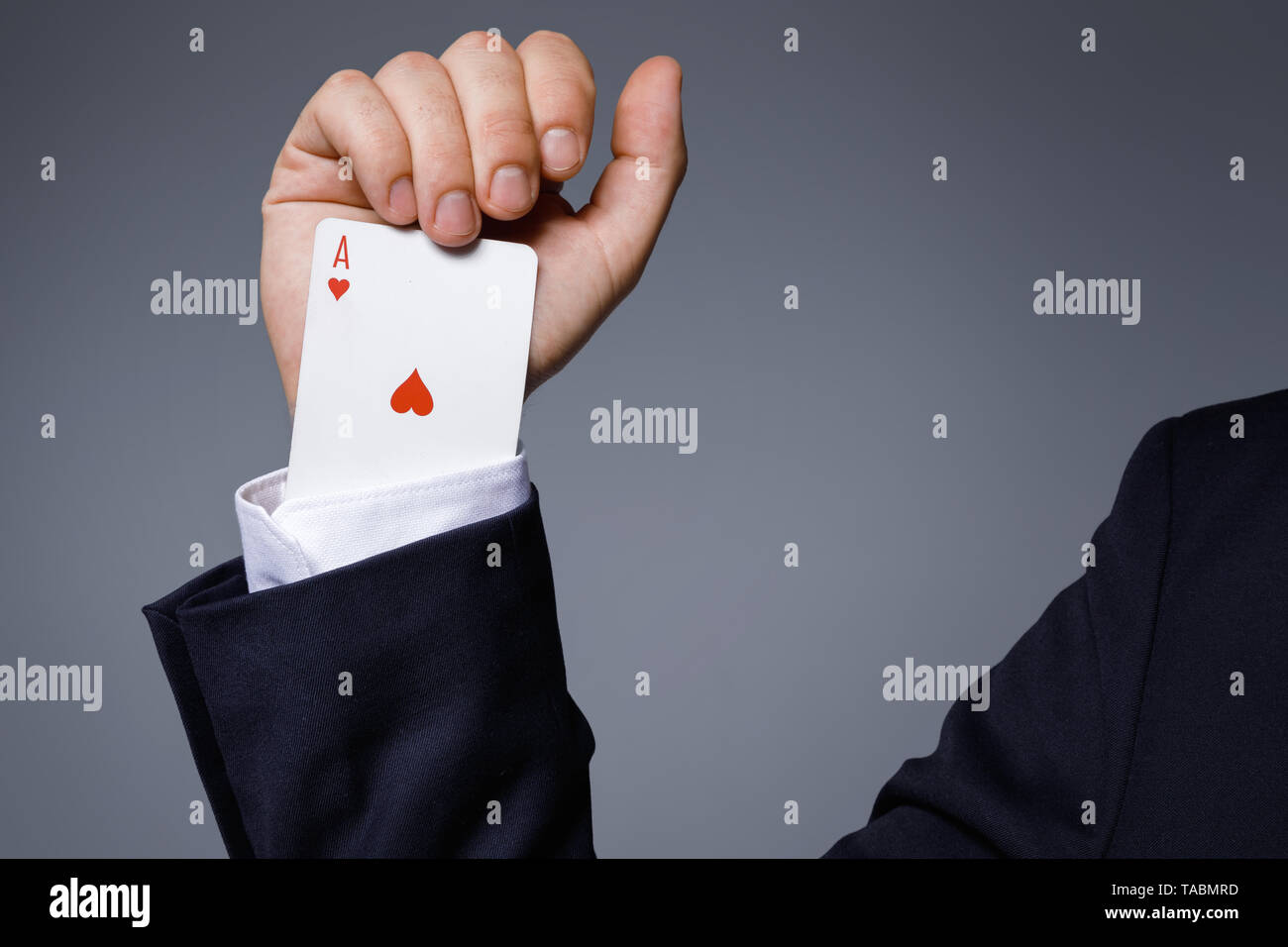 Gambling addiction concept  Man is hiding an Ace card in the