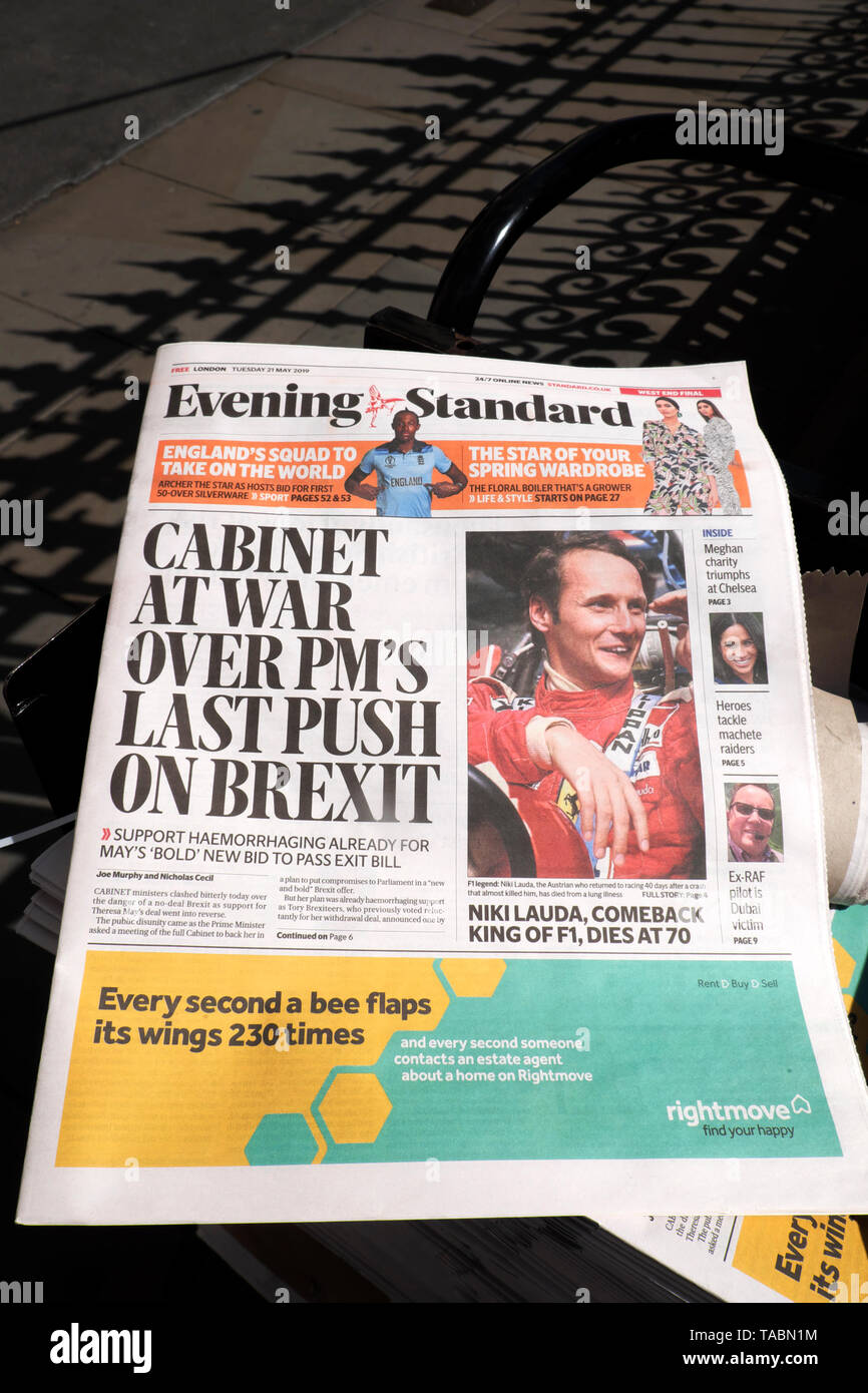 "Evening Standard Theresa May Brexit newspaper headline on newsstand ""Cabinet at War Over PM's Last Push on Brexit"" outside the Houses of Parliament in Westminster London UK  21 May 2019 Stock Photo"