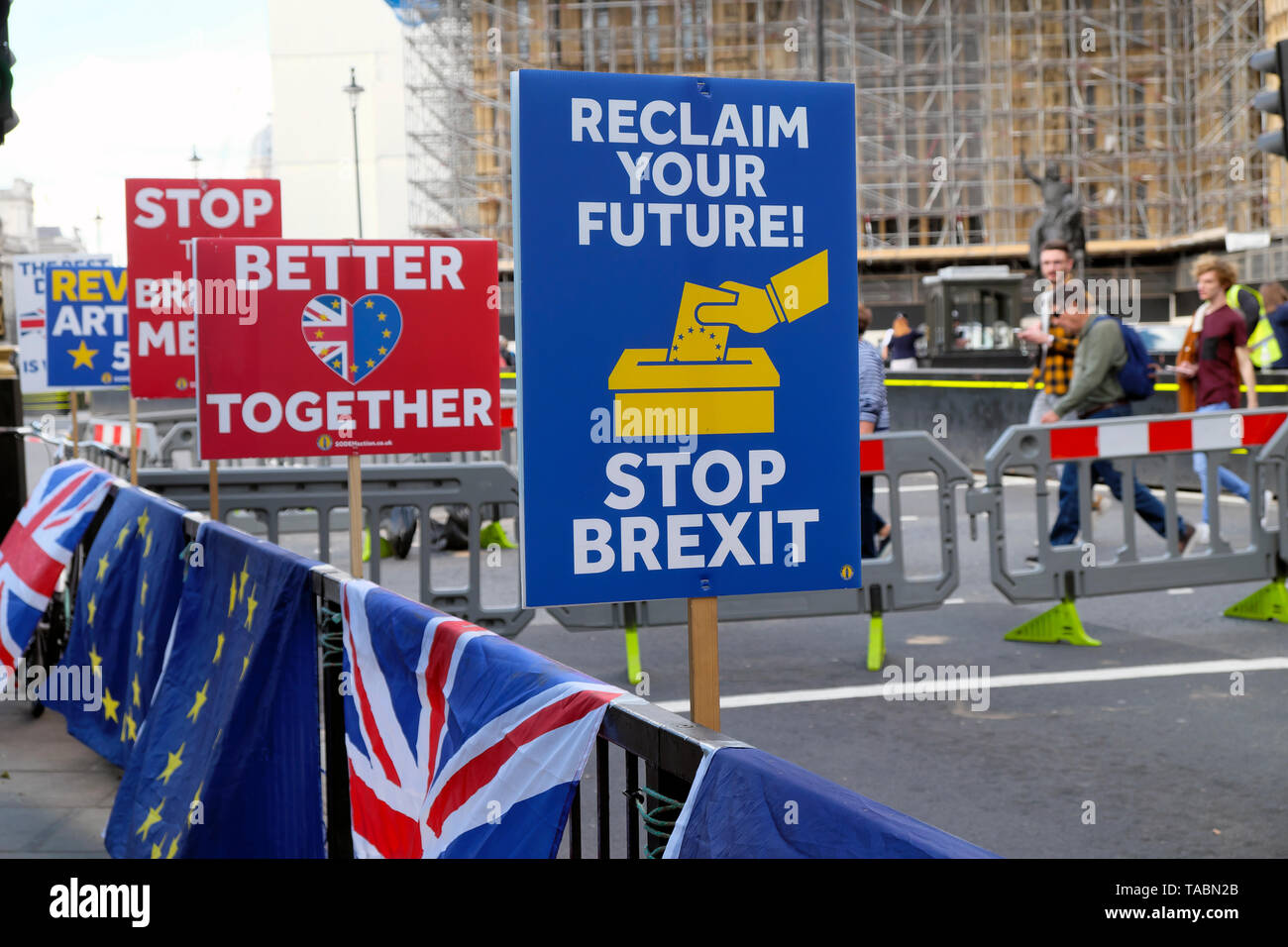 RECLAIM YOUR FUTURE, STOP BREXIT, BETTER TOGETHER heart and EU BREXIT STOP THE BREXIT MESS remain posters placards and flags and banners on barriers in the street outside the Houses of Parliament in Westminster London England UK 21 May 2019  KATHY DEWITT - Stock Image