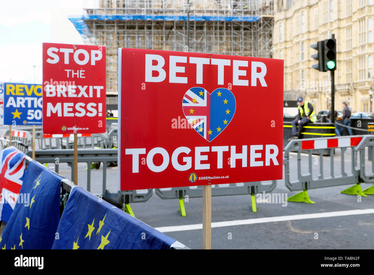 STOP THE BREXIT MESS! and BETTER TOGETHER EU BREXIT Remain poster placard and flags banners on barriers in the street outside the Houses of Parliament in Westminster London England UK 21 May 2019  KATHY DEWITT - Stock Image