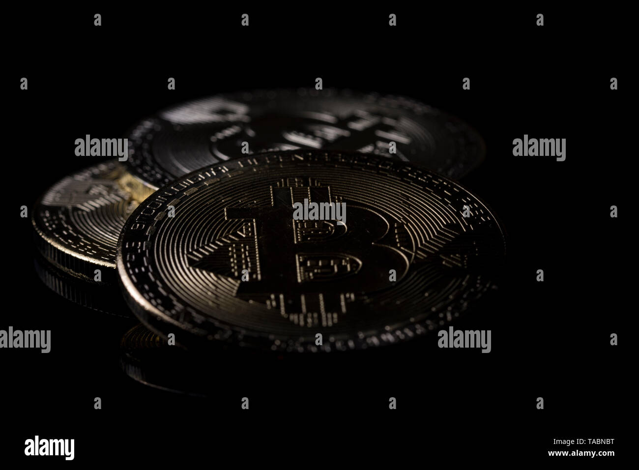 Panoramic view bitcoin close up isolated on black background digital coins. Buying, trading and selling cryptocurrencies. Digital money financial - Stock Image