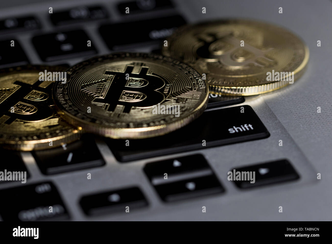 Bitcoin close up on computer keyboard. Investing in financial sector. Stock Photo