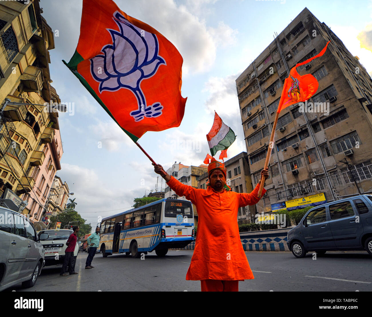 A supporter of Bharatiya Janata Party (BJP) seen weaving the BJP Flags in front of the Party Head quarter at Kolkata after making massive Win in West Bengal & India election. Bharatiya Janata Party (BJP) wins election in Kolkata, India. - Stock Image