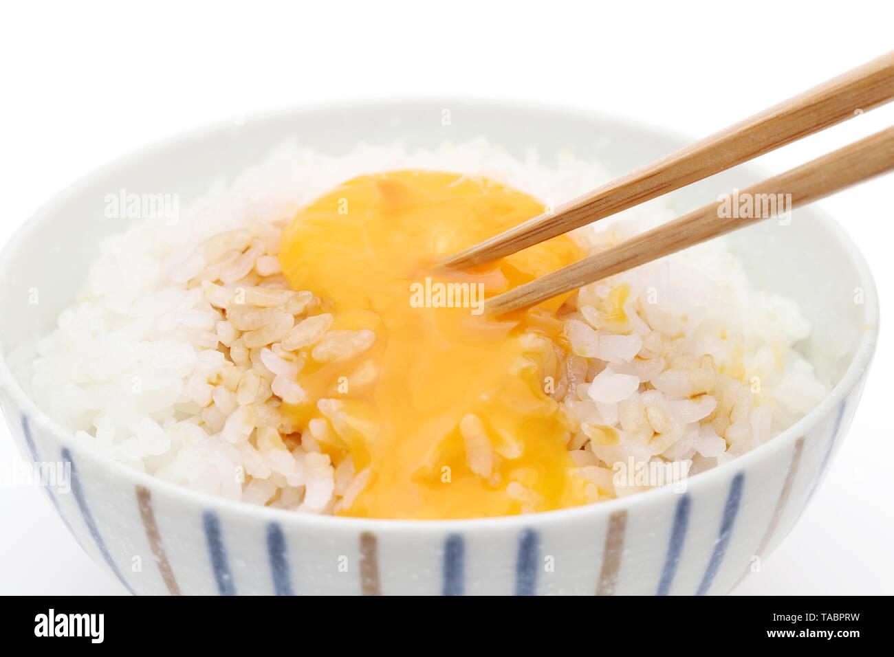 Japanese cooked rice with raw egg, Tamago kake gohan - Stock Image