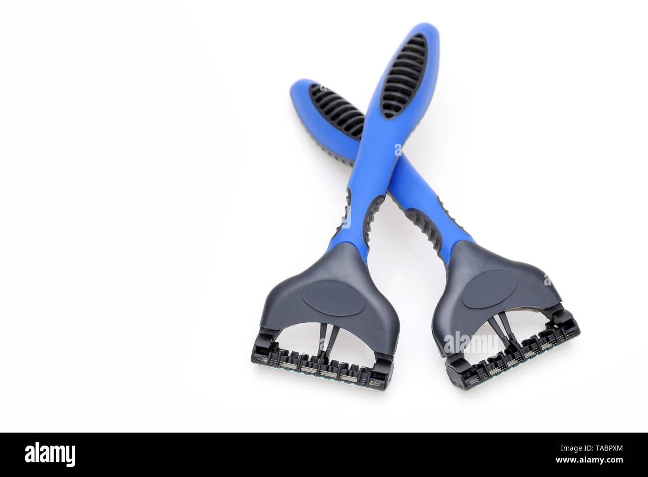blue disposable shaving razor on white background - Stock Image