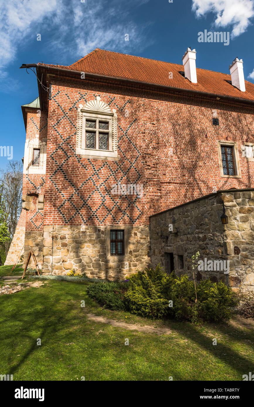 DEBNO, POLAND - APRIL 25, 2019: Late Gothic castle in Debno, near Tarnow, in spring scenery,Poland. Stock Photo
