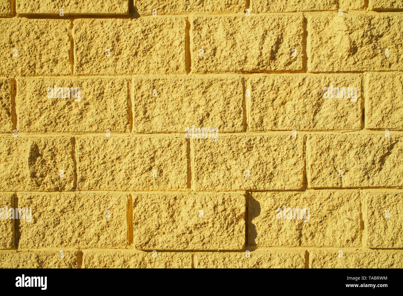 Decorative Imitation Of Brickwork Light Yellow Color The Wall Of