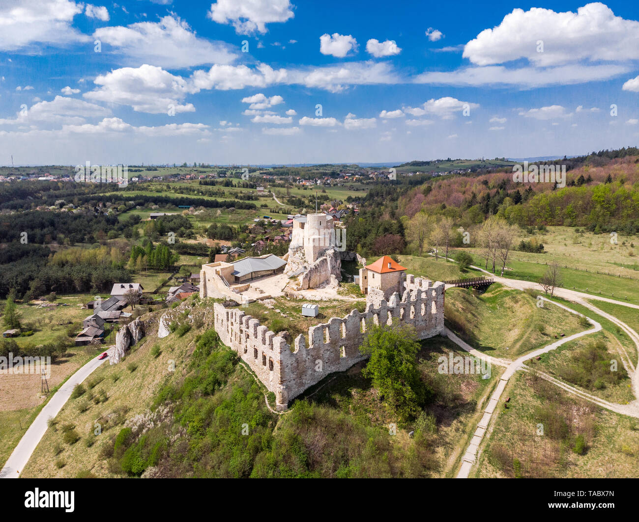 Aerial view of medieval Rabsztyn Castle ruins on hill top in sunny day, in Poland. Stock Photo