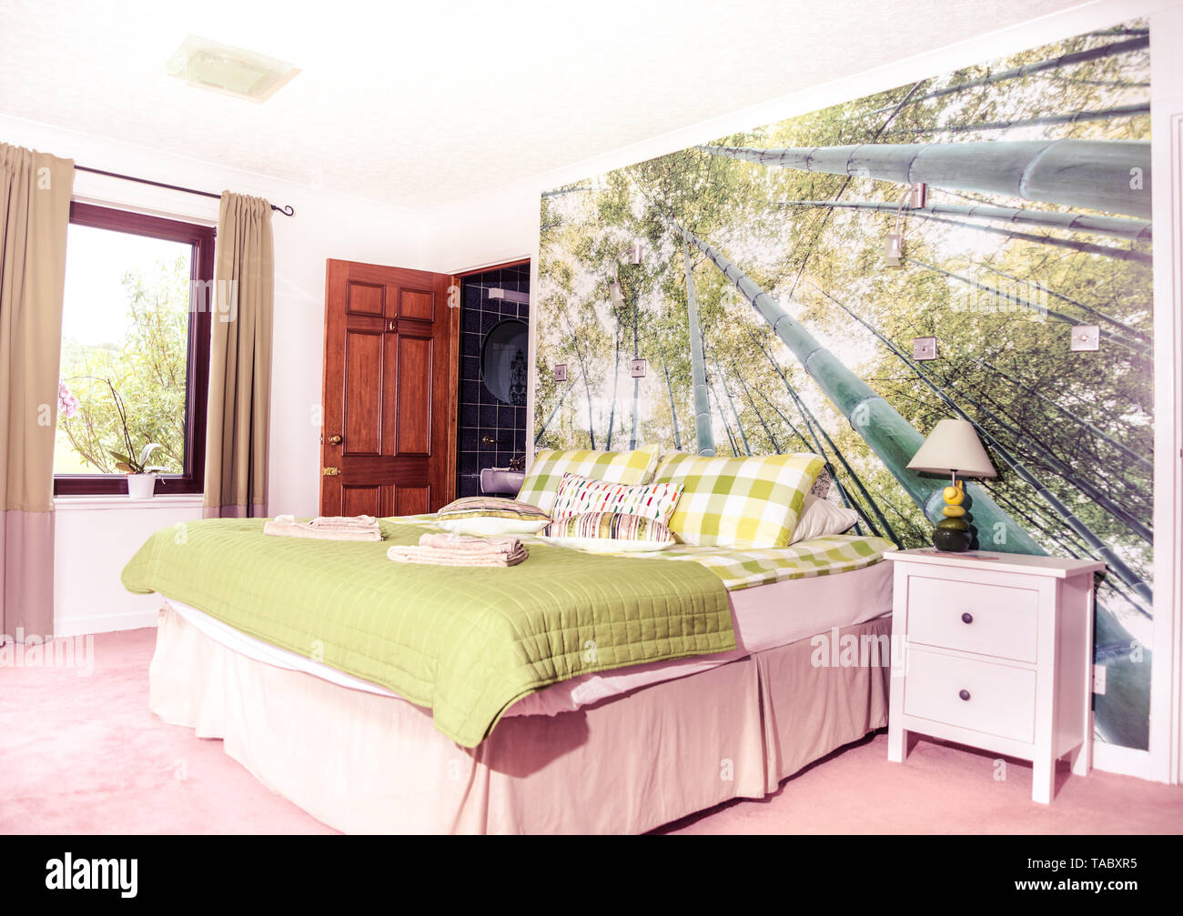 Tropical Forest Wallpaper In The Bedroom Stock Photo