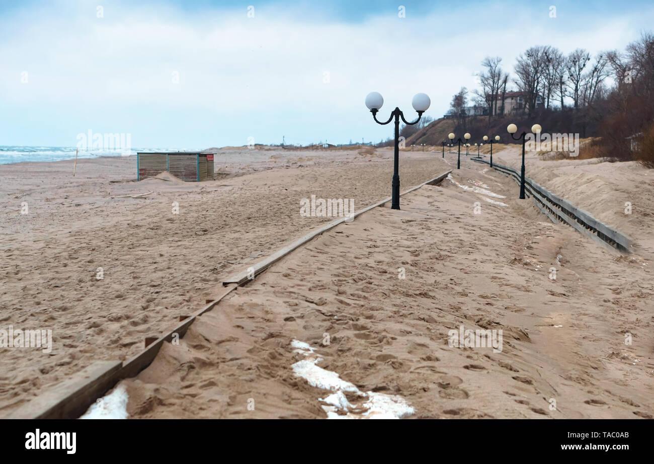 sand-covered promenade, sea promenade after storm, Yantarny village, Kaliningrad region, Russia, January 20, 2019 Stock Photo