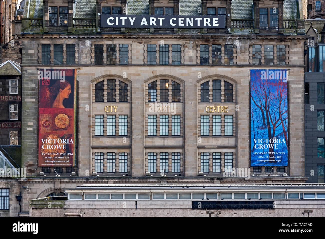 Banners for the Victoria Crowe exhibition, '50 Years of Painting', on the outside of the City Art Centre in Edinburgh's Old Town. - Stock Image
