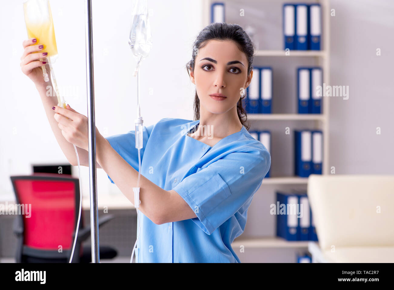 Young female doctor in infusion concept - Stock Image