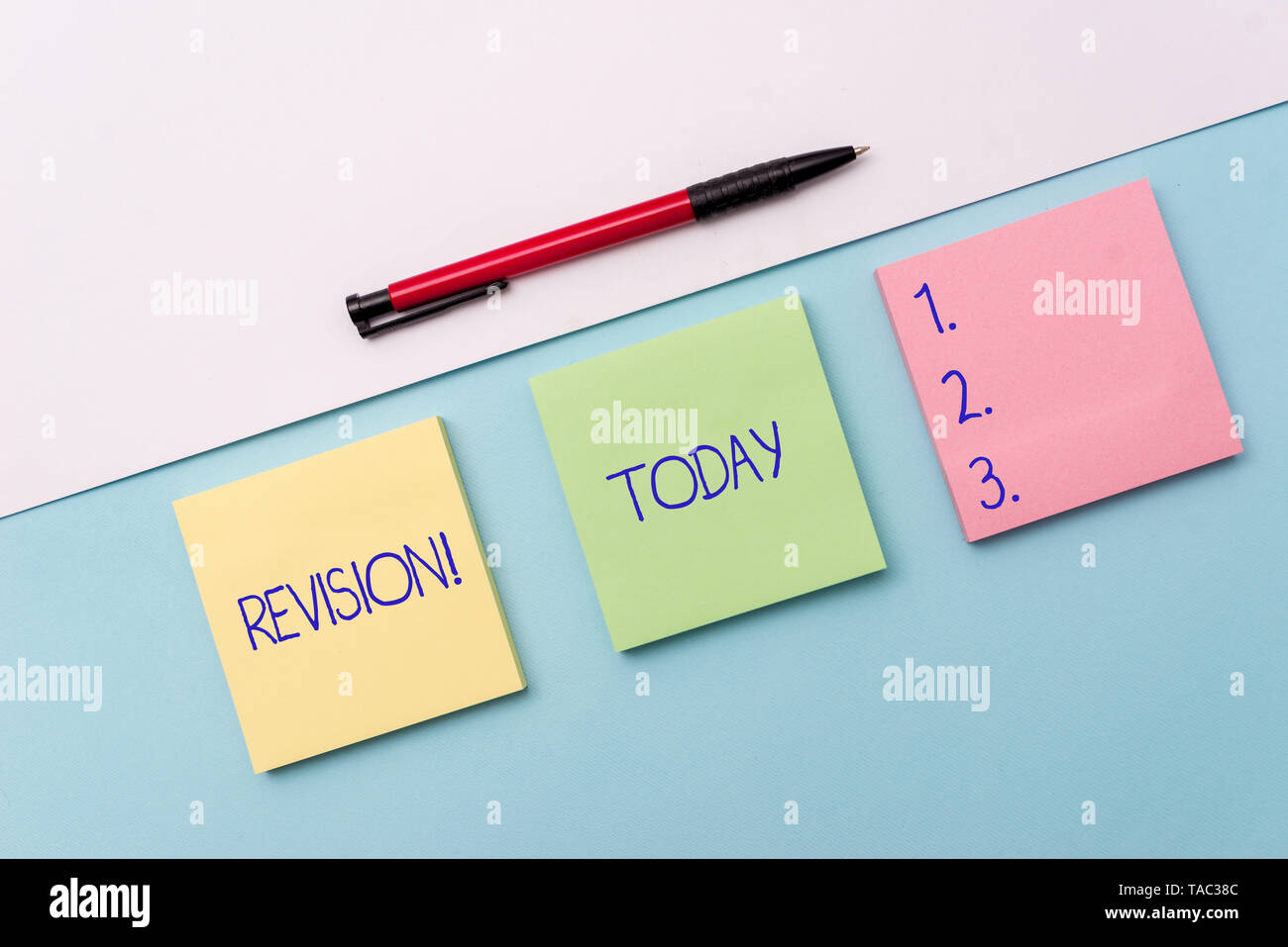 Conceptual hand writing showing Revision. Concept meaning action of revising over someone like auditing or accounting Stationary placed sideways on to - Stock Image