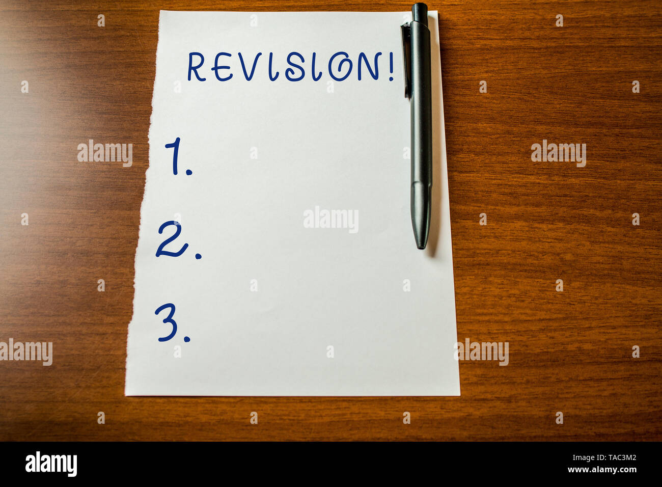 Handwriting text Revision. Conceptual photo action of revising over someone like auditing or accounting Upper view blank stationary paper lying wooden - Stock Image