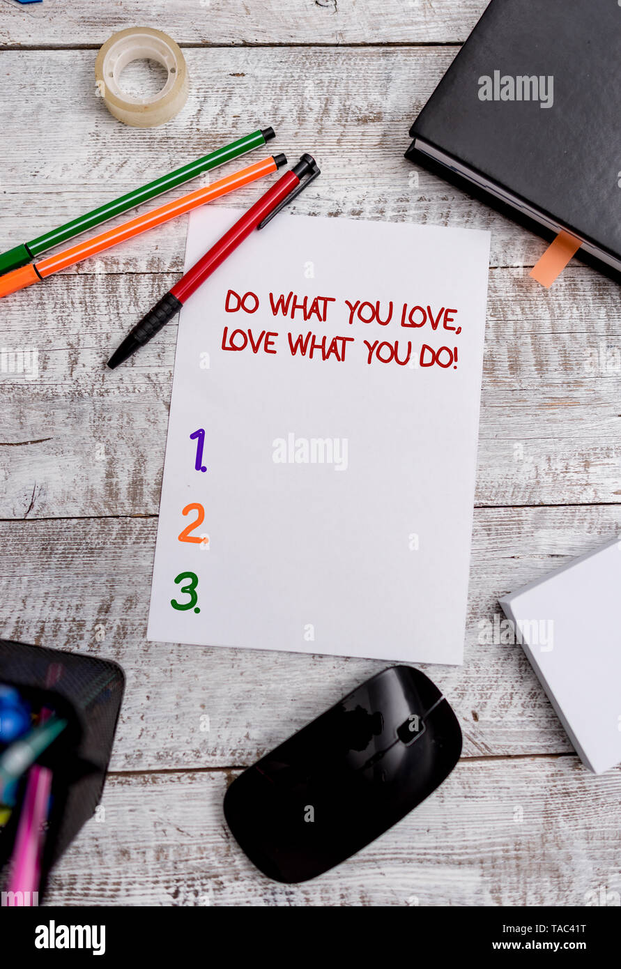Conceptual hand writing showing Do What You Love Love What You Do. Concept meaning you able doing stuff you enjoy it to work in better places then Sta - Stock Image