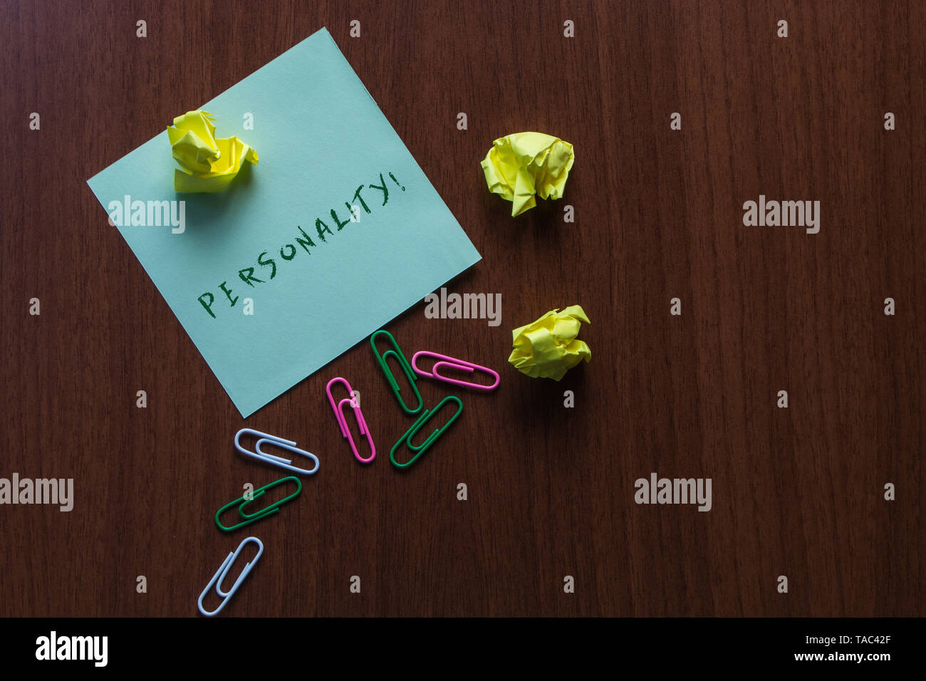 Word writing text Personality. Business photo showcasing combination characteristics that form individuals character Upper view three small paper ball - Stock Image