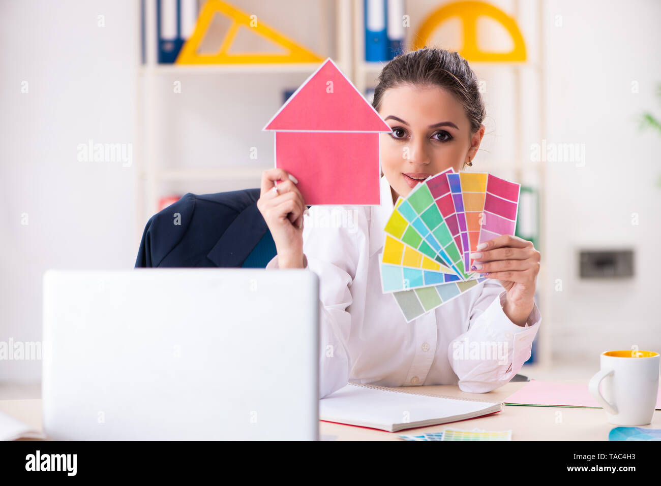 Female beautiful designer working in the office - Stock Image
