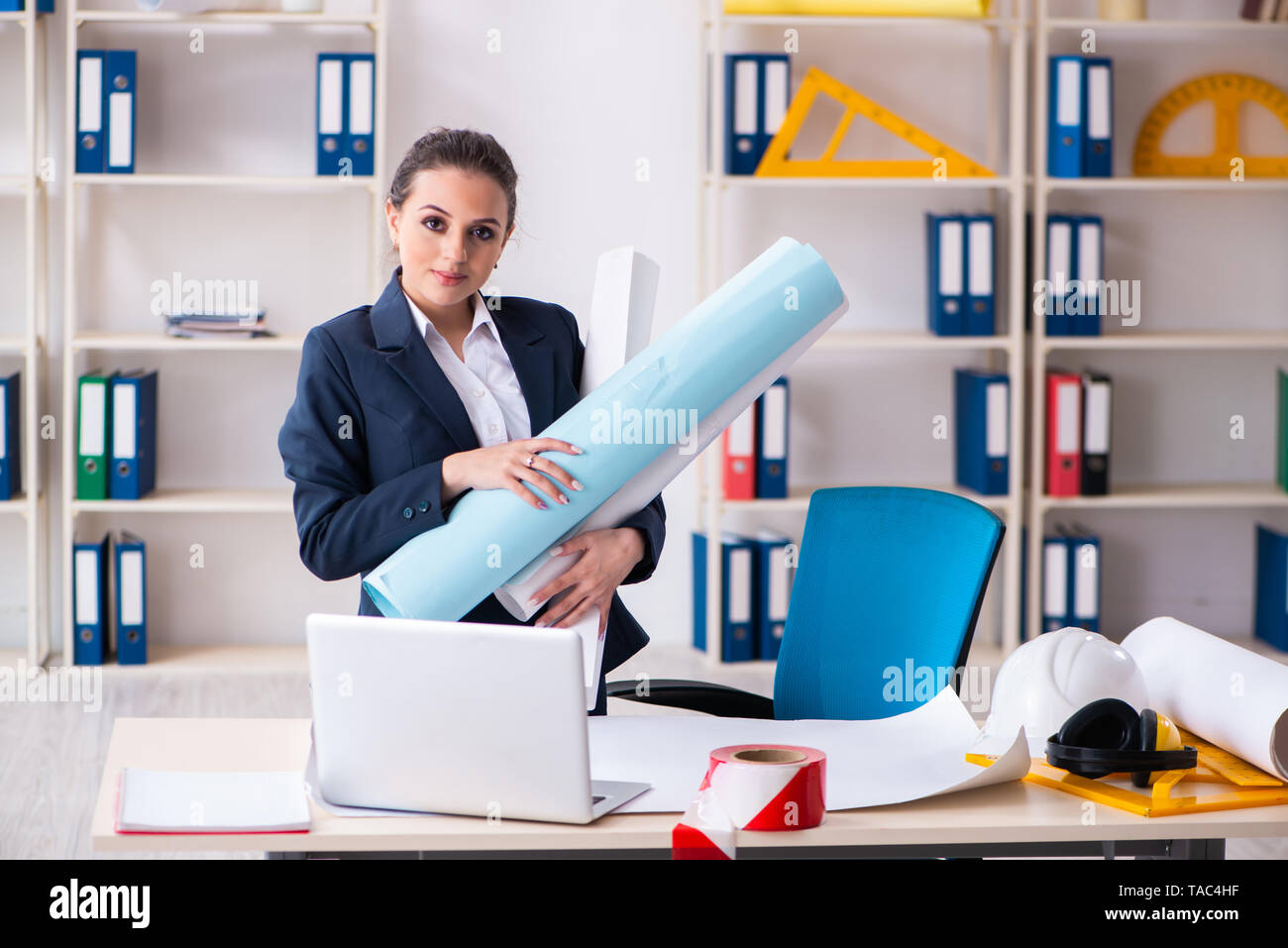 Young female architect working in the office - Stock Image