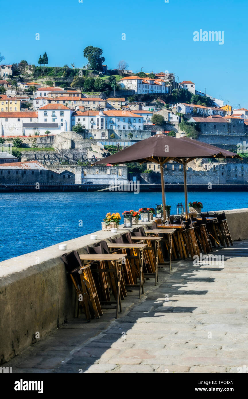 Portugal, Porto, Douro river, tables of an restaurant - Stock Image