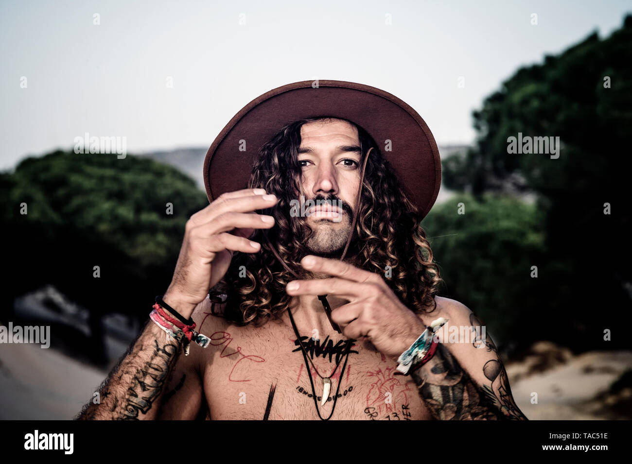 Young man with hat, tattoos and mustache Stock Photo
