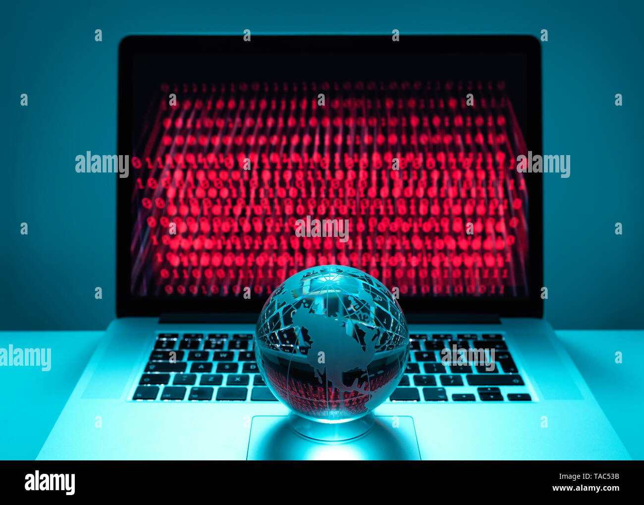 Globe illustrating the Americas on a laptop computer with screen been infected by a cyber attack Stock Photo