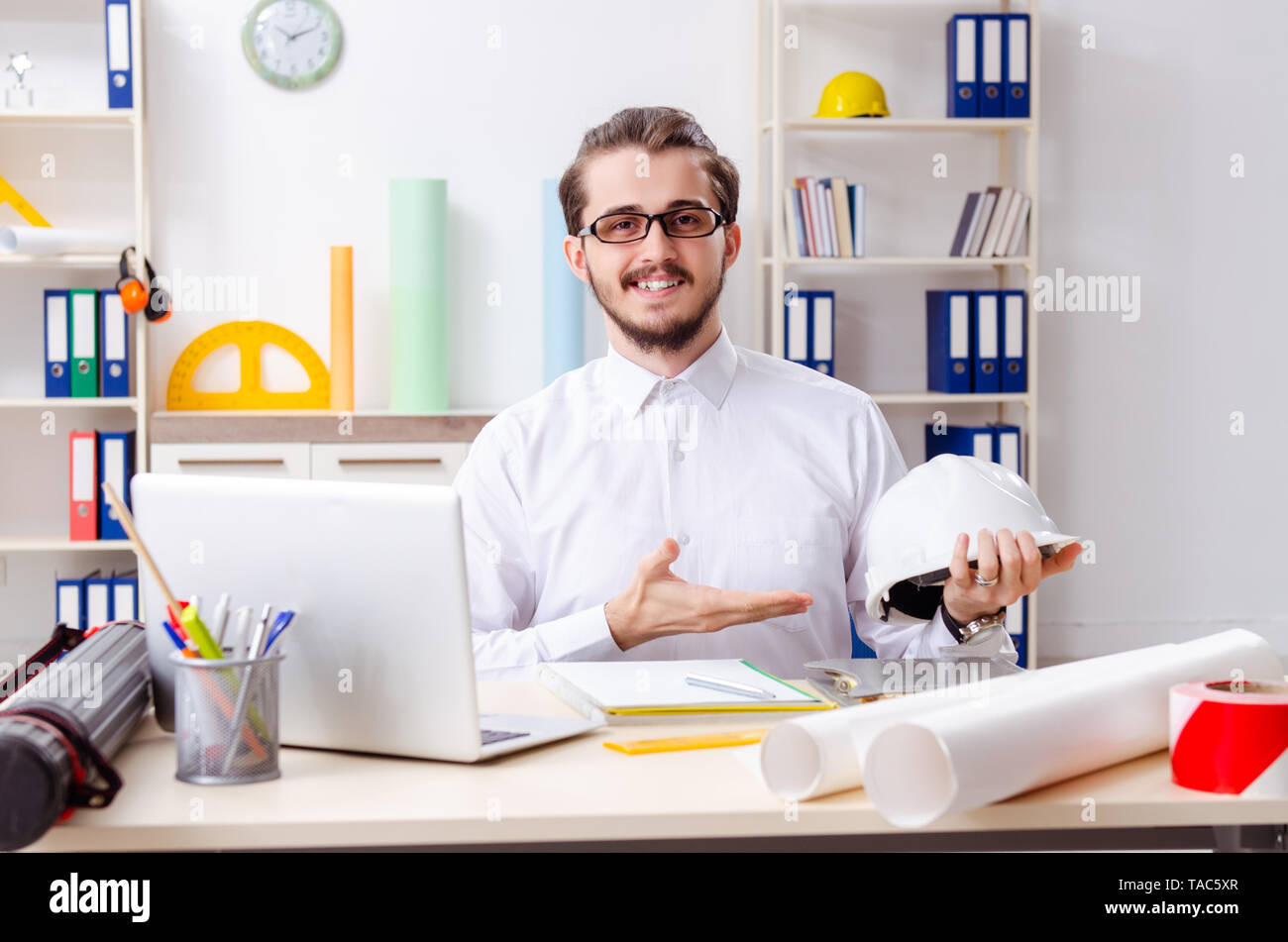 Young male architect working in the office - Stock Image