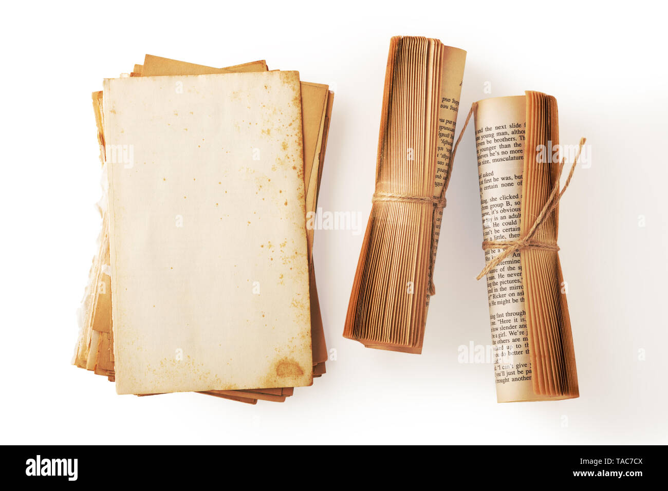 Old book paper and book roll with brown string tied, vintage book decor on white background - Stock Image