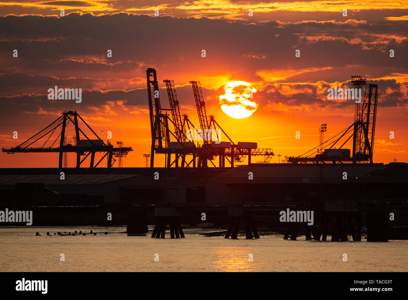 Gravesend, Kent, United Kingdom. 23rd May, 2019. Dramatic sunset over the River Thames seen from Gravesend looking towards Tilbury Docks. Rob Powell/Alamy Live News Stock Photo
