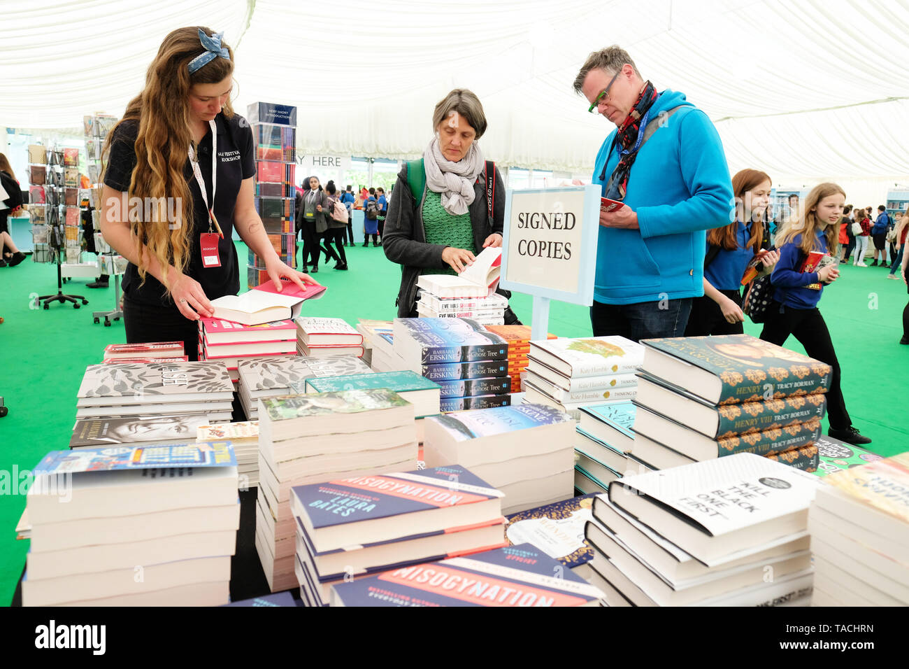 Hay Festival, Hay on Wye, Powys, Wales, UK - Friday 24th May 2019 - Visitors browses the Signed Copies section of books in the Festival bookshop on the second day of this years Hay Festival - Credit: Steven May/Alamy Live News - Stock Image