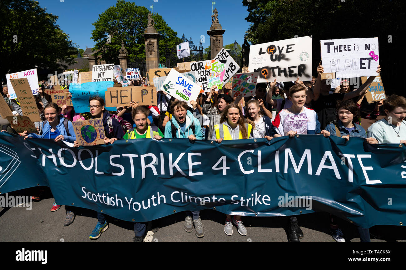 Edinburgh, Scotland, UK. 24th May, 2019. Scottish Youth Climate Strike by schoolchildren in central Edinburgh. Students took a day off school to meet in The Meadows park before marching along the Royal Mile to a protest held outside the Scottish Parliament at Holyrood. The protest is to coincide with the second global school strike for climate - along with over 1500 locations around the world. The strikes were started in August 2018 by the Swedish schoolgirl Greta Thunberg and have since been mirrored across the world.  Credit: Iain Masterton/Alamy Live News - Stock Image