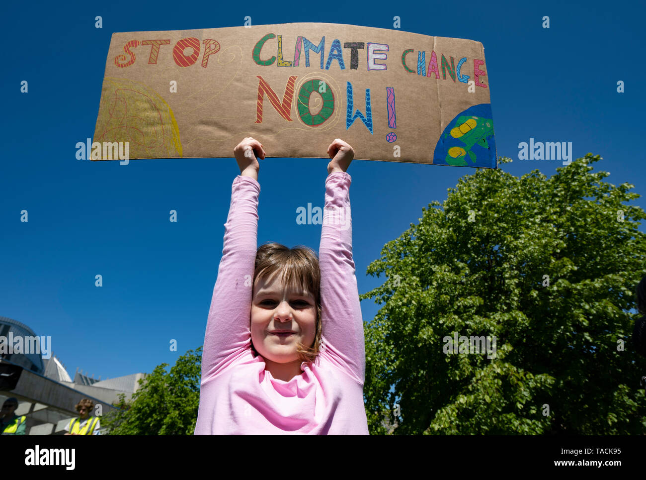 Edinburgh, Scotland, UK. 24th May, 2019. Scottish Youth Climate Strike by schoolchildren in central Edinburgh. Students took a day off school to meet in The Meadows park before marching along the Royal Mile to a protest held outside the Scottish Parliament at Holyrood. The protest is to coincide with the second global school strike for climate - along with over 1500 locations around the world. The strikes were started in August 2018 by the Swedish schoolgirl Greta Thunberg and have since been mirrored across the world.  pictured; young girl holds sign Credit: Iain Masterton/Alamy Live News - Stock Image