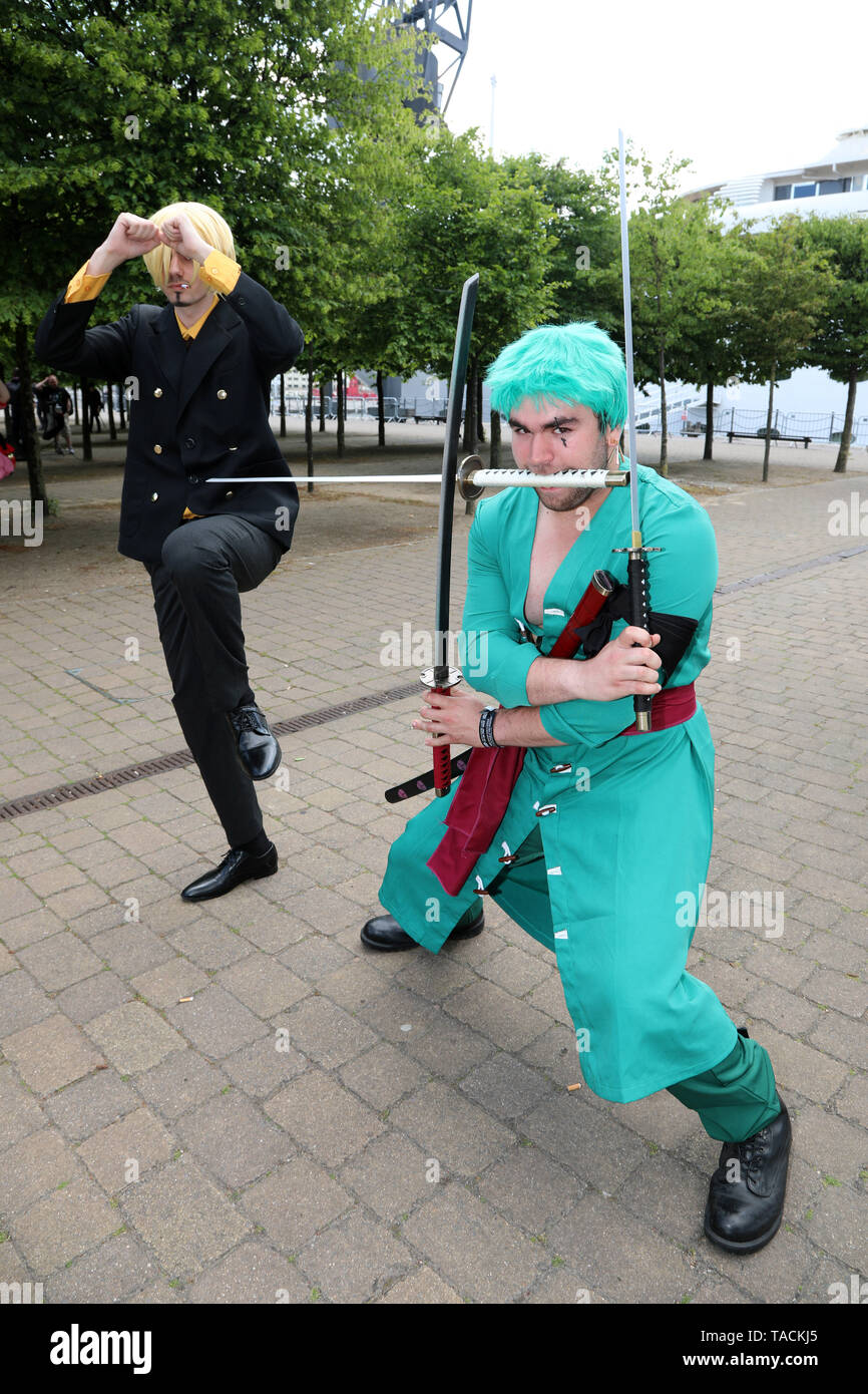 London, UK. 24th May, 2019. London, UK. 24th May 2019. Sanji and Zoro from One Piece at the MCM London Comic Con at Excel in London Credit: Paul Brown/Alamy Live News - Stock Image