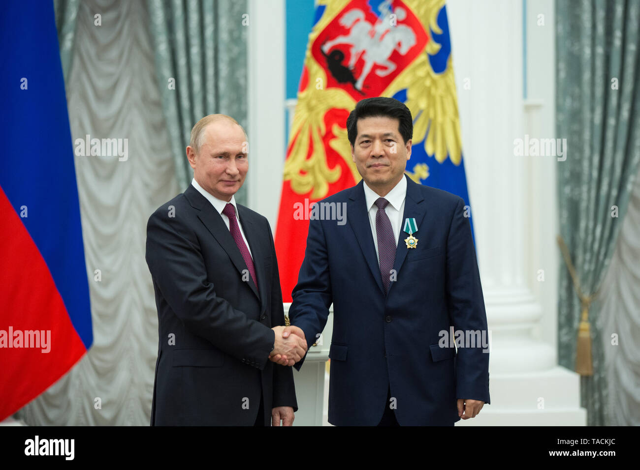 Moscow, Russia. 23rd May, 2019. Russian President Vladimir Putin (L) presents the Order of Friendship to the Chinese Ambassador to Russia Li Hui in Moscow, Russia, May 23, 2019. Credit: Qu Haiqi/Xinhua/Alamy Live News - Stock Image