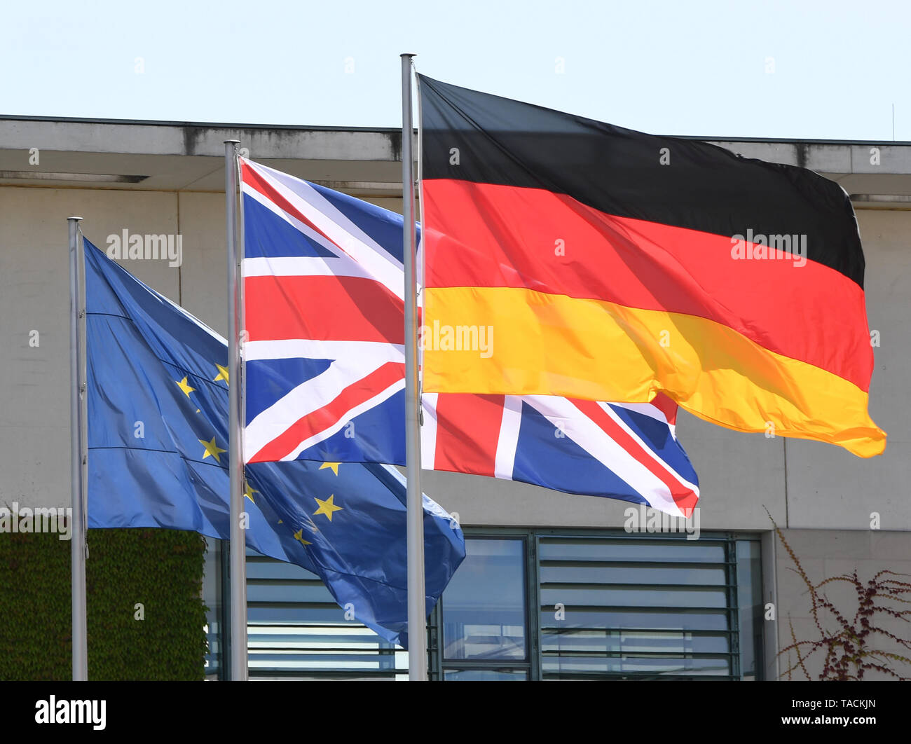Berlin, Germany. 20th July, 2016. A European Union (EU, L-R), a British and a German national flag flying in front of the Federal Chancellery in Berlin, Germany, 20 July 2016. German Chancellor Angela Merkel received British Prime Minister Theresa May on the same day. Credit: Soeren Stache/dpa | usage worldwide/dpa/Alamy Live News - Stock Image