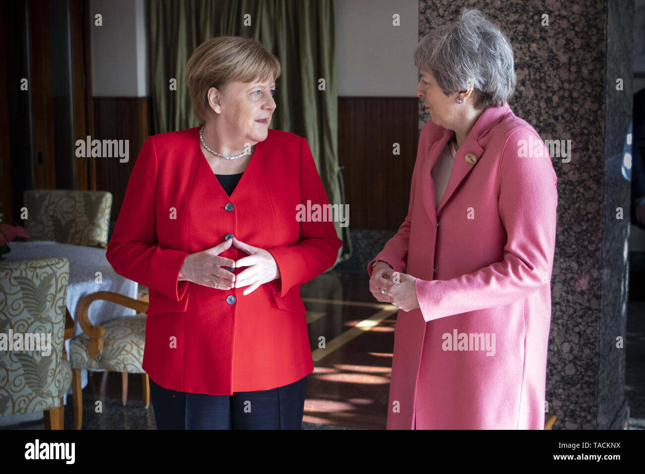 Sharm El Sheikh, Egypt. 25th Feb, 2019. German Chancellor Angela Merkel (L) meets with British Prime Minister Theresa May on the sidelines of the European Union (EU) and League of Arab States (LAS) summit. Credit: Guido Bergmann/Bundesregierung/dpa - ATTENTION: editorial use only and only if the credit mentioned above is referenced in full | usage worldwide/dpa/Alamy Live News - Stock Image