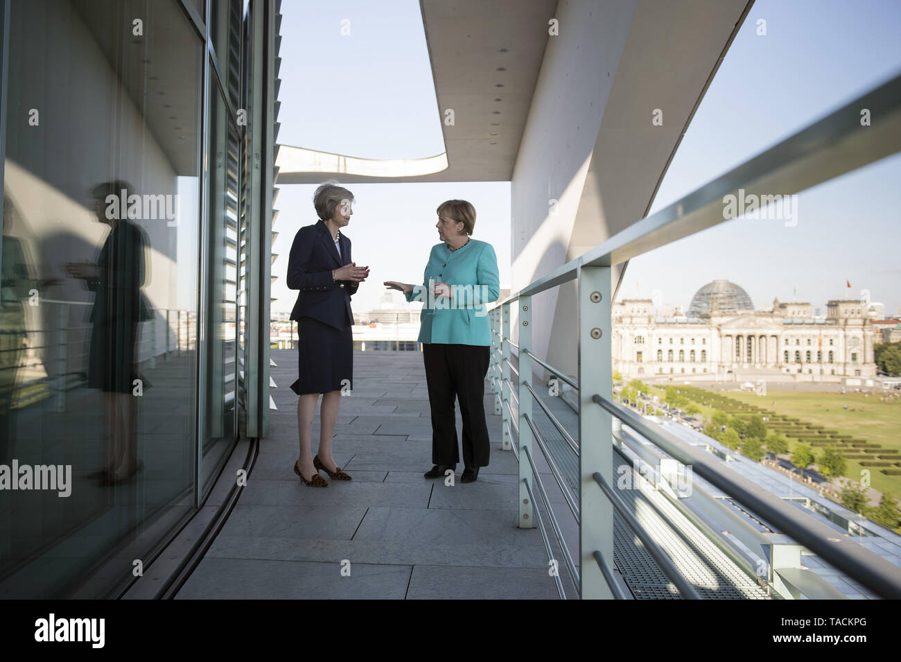 Berlin, Germany. 20th July, 2016. HANDOUT - A handout picture made available by the German Federal Government (Bundesregierung) shows German Chancellor Angela Merkel (R) and new British Prime Minister Theresa May holding wine glasses on the balcony during their meeting in the Federal Chancellery in Berlin, Germany, 20 July 2016. Credit: Guido Bergmann/Bundesregierung/dpa (ATTENTION EDITORS: EDITORIAL USE ONLY IN CONNECTION WITH CURRENT REPORTING/MANDATORY CREDITS: 'Guido Bergmann/Bundesregierung/dpa') | usage worldwide/dpa/Alamy Live News - Stock Image