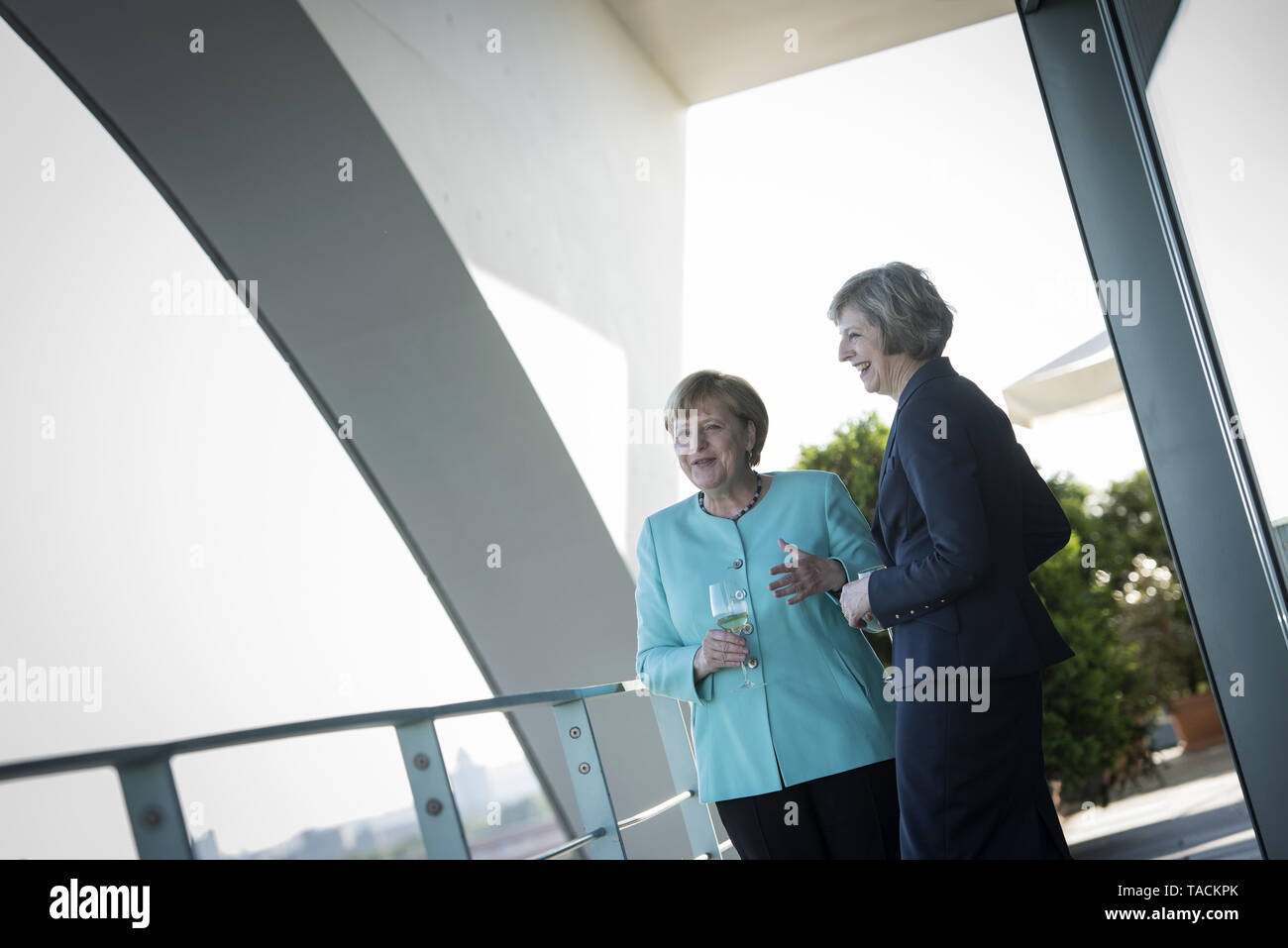 Berlin, Germany. 20th July, 2016. HANDOUT - A handout picture made available by the German Federal Government (Bundesregierung) shows German Chancellor Angela Merkel (L) and new British Prime Minister Theresa May holding wine glasses during their meeting in the Federal Chancellery in Berlin, Germany, 20 July 2016. Credit: Guido Bergmann/Bundesregierung/dpa (ATTENTION EDITORS: EDITORIAL USE ONLY IN CONNECTION WITH CURRENT REPORTING/MANDATORY CREDITS: 'Guido Bergmann/Bundesregierung/dpa') | usage worldwide/dpa/Alamy Live News - Stock Image